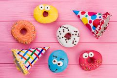 Birthday party background with donuts and cone hats. stock image