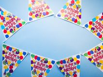 Birthday party banner blue background. Flat lay Royalty Free Stock Photography