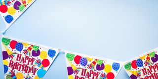 Birthday party banner blue background. Flat lay Royalty Free Stock Images