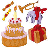 Birthday party. Cake, present, toy Royalty Free Stock Photos