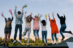 Birthday party celebration. Students company. Jumps. Young people on holiday, sky background, friendship concept royalty free stock image