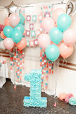 Birthday party for child one years old. Pink, mint and white colors. Stylish Birthday decorations and big number one stock photos
