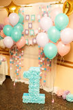 Birthday party for child one years old. Pink, mint and white colors. Stylish Birthday decorations and big number one royalty free stock photography