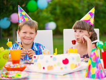 Birthday party with colorful cake at backyard Stock Image