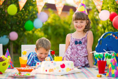 Birthday party with colorful cake at backyard Royalty Free Stock Images