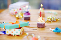 Birthday party with colorful decoration and cakes with candles Royalty Free Stock Photos
