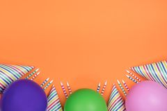 Birthday party composition on orange background. Top view with c royalty free stock photo
