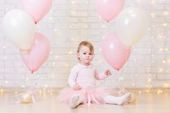 Birthday party concept - little girl over brick wall background Stock Images