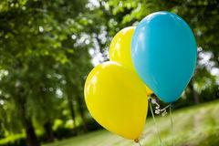 Birthday party decorations. Yellow and blue ballons Stock Photo