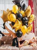 Birthday party delighted blonde lady balloons royalty free stock photos