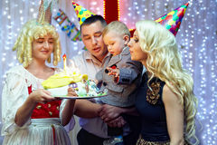 Birthday party. family blowing candles on cake Stock Photo