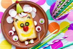 Birthday party food idea for kids clown sandwich. Top view stock image