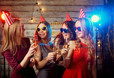 Birthday party girlfriends. Beautiful girl in a cap with glasses. Of champagne stock photo