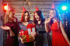 Birthday party girlfriends girls. Yong woman in hats with presen Royalty Free Stock Photos