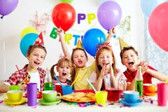 Birthday party. Group of adorable kids having fun at birthday party Stock Photography