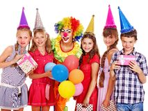 Birthday party group of teen with clown. Birthday party group of teen people with clown. Isolated royalty free stock photos