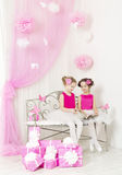 Birthday party happy kids with presents. Girl gift boxes Stock Photos