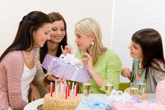 Birthday party - happy woman getting present Royalty Free Stock Image
