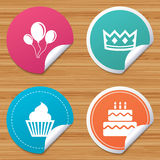 Birthday party icons. Cake and cupcake symbol. Round stickers or website banners. Birthday crown party icons. Cake and cupcake signs. Air balloons with rope Royalty Free Stock Photos