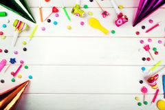 Birthday party items and decorations on white wood background. Top view Royalty Free Stock Photos