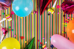 birthday party items on striped background with copy space stock image