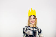 Birthday party, new year carnival. Young smiling woman on white background celebrating brightful event, wears stripped stock images