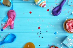 Free Birthday Party Objects On Blue Wooden Background, Stock Images - 105733484
