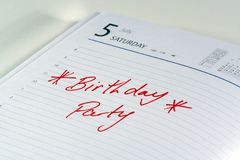 Birthday Party Reminder. A diary showing the reminder for a birthday party Stock Images
