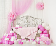 Birthday party room background with gift boxes. Kids celebration. Presents girl or woman Stock Photos