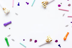 Birthday party set with confetti on white background top view mock up. Birthday party set with colorful confetti on white desk background top view mock up stock image
