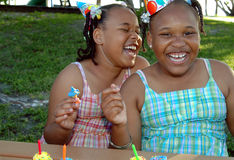 Birthday party sisters Stock Photos