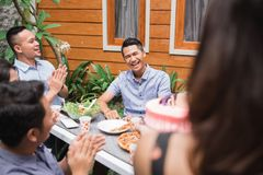 Birthday party surprise with friends. Group of friends celebrating birthday in the garden. surprise party Royalty Free Stock Image