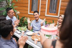 Birthday party surprise with friends. Group of friends celebrating birthday in the garden. surprise party Royalty Free Stock Photo