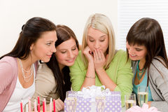 Birthday party - surprised woman getting present Stock Images