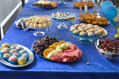 Birthday party table decoration with food Stock Photos