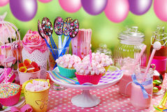 Birthday party table for kids. Mini marshmallow cupcakes chocolate spoons and other sweets on & Girl Birthday Party Pink Table Setting Stock Images - 72 Photos