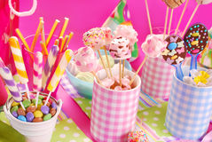 Birthday party table with marshmallow pops and other sweets for stock photos