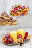Birthday party table setting: food and floral decorations Stock Photos