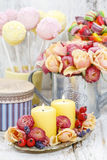 Birthday party table setting: food and floral decorations Stock Image