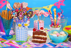 Birthday party table with torte and  sweets for kids Stock Photos