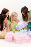 Birthday party - woman getting present. With champagne and cake Royalty Free Stock Photography