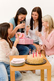 Birthday party - woman getting present and flower Stock Image