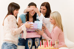 Birthday party - woman getting present, surprise. Cake Royalty Free Stock Image