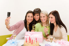 Birthday party - woman take photo with camera Stock Photo