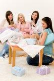 Birthday party - woman unwrap present, celebrate stock photo