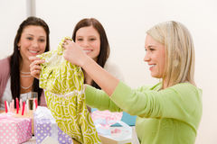 Birthday party - woman unwrap present, surprise Stock Image