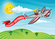 Birthday plane. A boy flying an airplane with a Happy Birthday banner Stock Photography