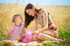 Birthday present for little girl at grain field Stock Photos