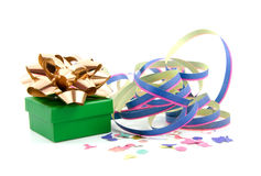Birthday present with streamer. Green birthday present with golden bow and party streamer over white background Royalty Free Stock Photos