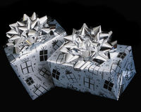 Birthday presents wrapped in silver Stock Photo